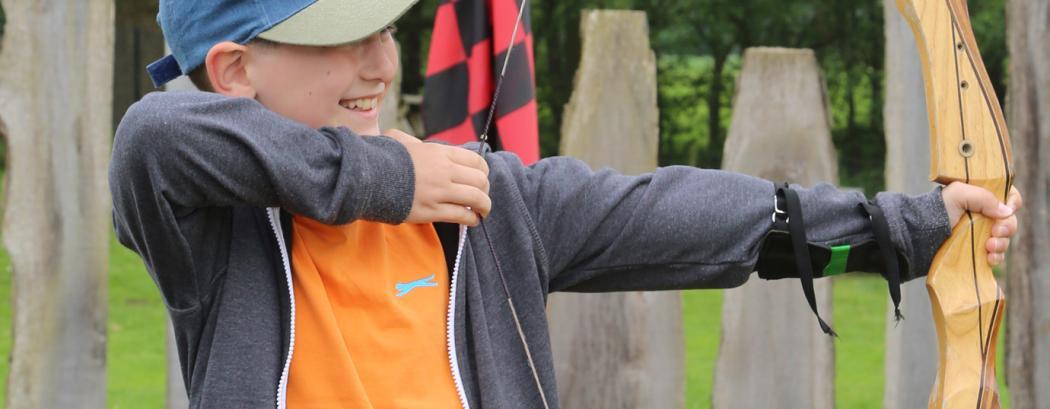 Primary school child on the archery range | JCA