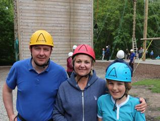 Family at high ropes tower