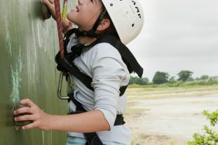 Girl climbing a wall at condover
