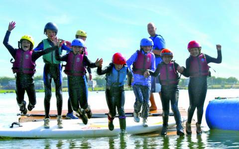 Students jumping into water at Croft Farm