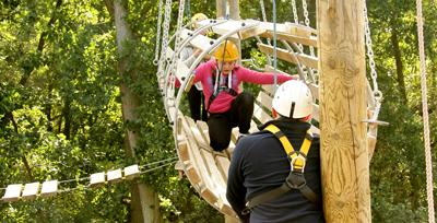 Students being supported on the high aerial trek