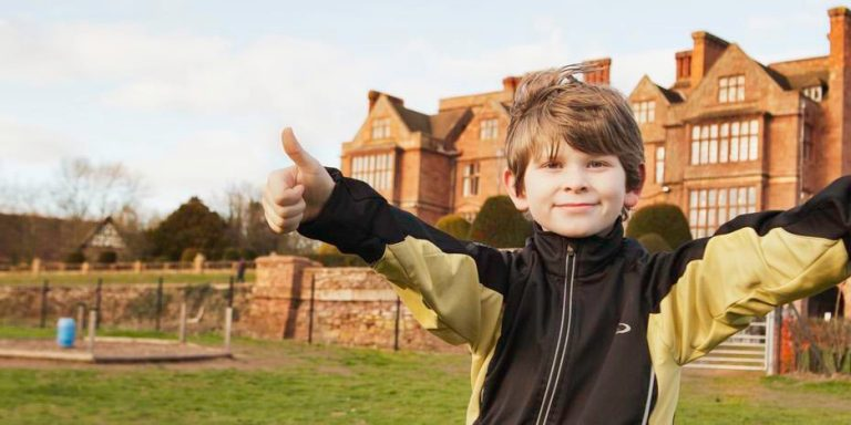 Child with thumbs up outside Condover Hall | JCA