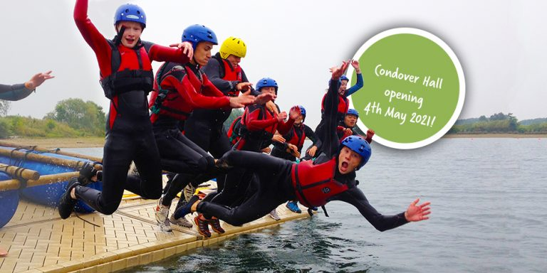 Students jumping off raft